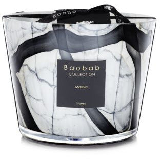 Leather – Tuberose – Berries  The scented candle is set in a hand blown glass replicating grey marble with black strokes edged with beige. The elegance of the glass reveals the flame, giving an effect of a luminous stone.