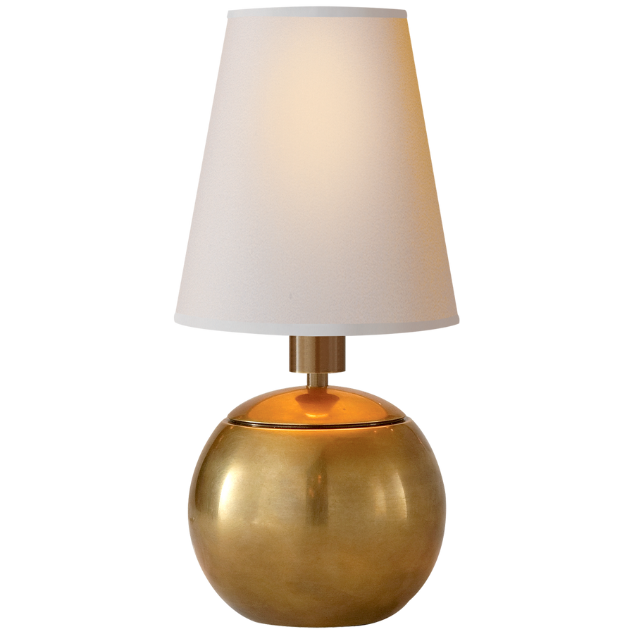 "DESIGNER: THOMAS O'BRIEN  Finish: Hand-Rubber Antique Brass  Shade: 3"" x 5"" x 5.5"" Natural Paper   SPECIFICATIONS: Height: 10.25"" Width: 5"" Base: 2.25"" Round Shade Details: 3"" X 5"" X 5.5"" Socket: E12 Candelabra W/ Line Switch Wattage: 40 B French Wired"