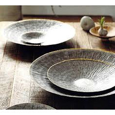 Our Sahara Trays are made from hand-hammered galvanized iron sheets. They make for an elegant tabletop display with their rustic ripple texture and brass edging.  Set of 5.