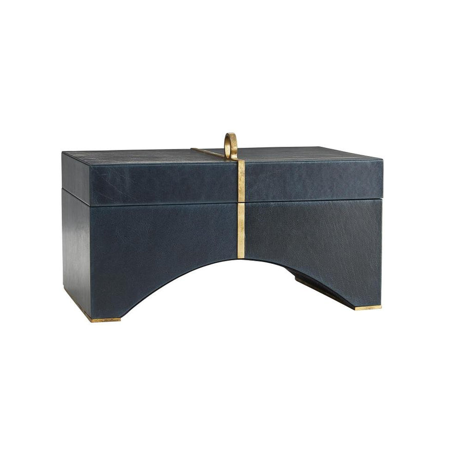 This natural leather box is the perfect size for safely storing jewelry, keepsakes and miscellaneous items. The fine execution of the antique brass inlay, which runs across the top to the center of the arched bottom, delivers a refined element to its natural materials. The inside is lined with a suede interior to protect your treasures. Antique brass feet keep the box slightly raised, which adds an additional element of classic style. Leather may vary.  H: 6in W: 10in D: 7in