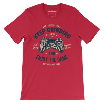 Keep grinding and enjoy the game written with illustration of a gaming controller on red t-shirt for both men and women