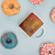 11oz Ceramic, white and glossy coffee mug with abstract painting painted with colorful donuts around from Teexpression