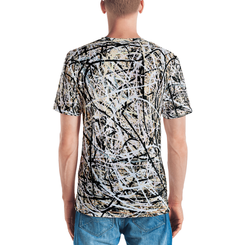 "Front view of a man on all-over shirt, which appears like an expressionist painting of Pollock and has a phrase ""I'M AN ARTIST"" printed on them  from Teexpression"