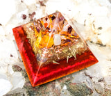 Red and gold Orgone Pyramid to manifest abundance