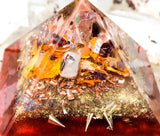 Orgone crystal pyramid made with garnet, carnelian, and amethyst