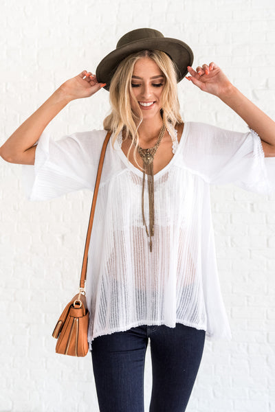 white boutique top with raw edges