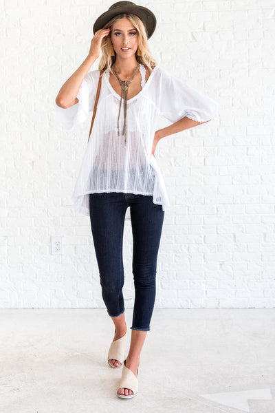 white boutique top with short sleeves