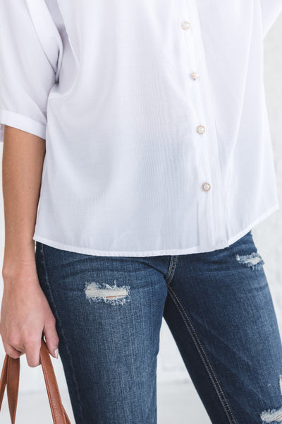 white boutique blouse with short sleeves
