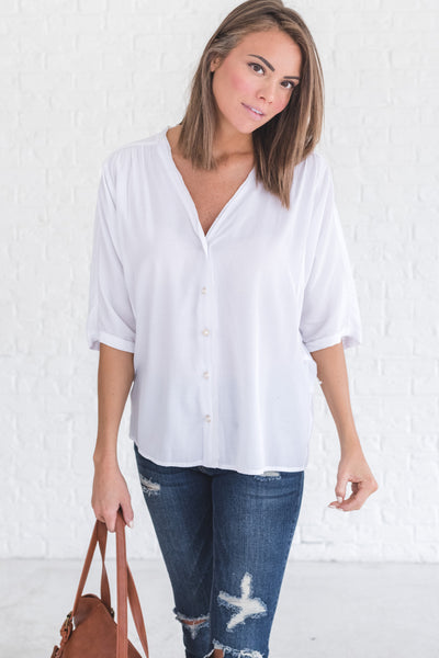 white boutique blouse with pearl buttons