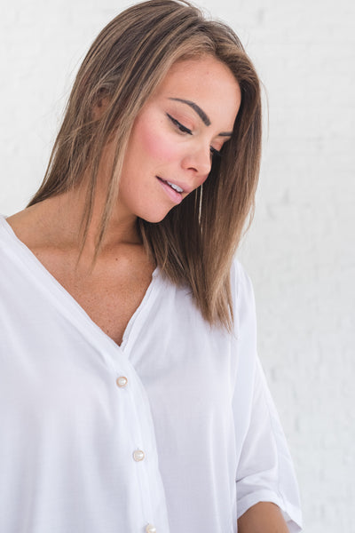 white boutique blouse