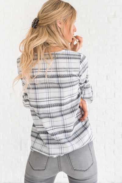 white boutique top with black and blue plaid pattern