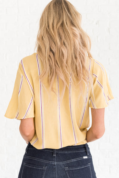 yellow boutique top with short sleeves