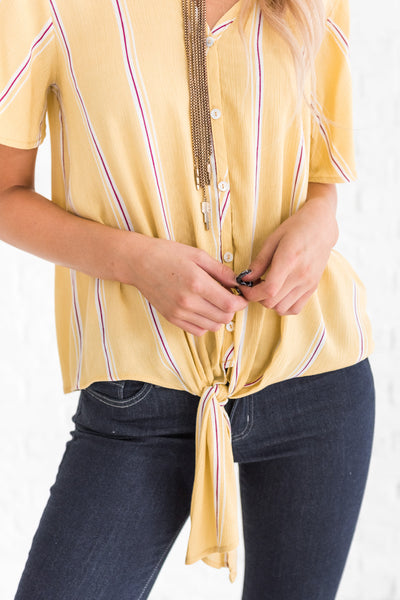 yellow boutique top with button-up front