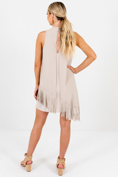 Beige Mini Dress with Asymmetrical Overlay and Fringe Accents