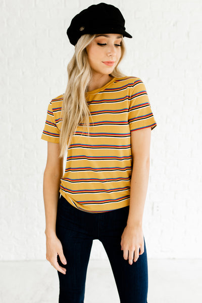 Mustard Yellow Striped Boutique Tops for Women with Red, White, Black, Red, and Blue Accents