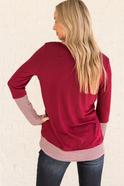 Burgundy Red Long Sleeve Thumbhole Top with Striped Accents on the Sleeves and Hem