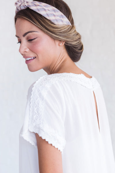 boutique top with lace embroidery details
