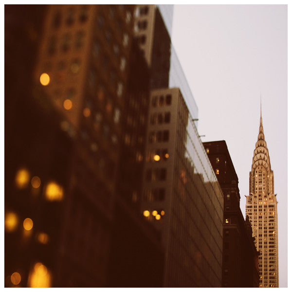 Night falls upon New York and the Chrysler Building.