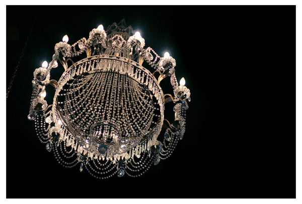 Dramatic, fine art photograph of a crystal chandelier. Photographed  by Alicia Bock.