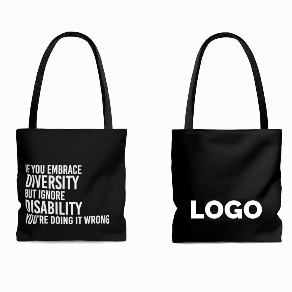 "Front and Back View of Uncomfortable Revolution Branded Diversity and Inclusion Merchandise - Black Tote that says ""If you Embrace Diversity but Ignore Disability, You're Doing it Wrong"" in all white caps. The back view has a placeholder logo."