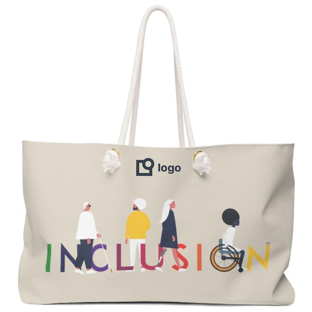 Photo of Uncomfortable Revolution Diversity and Inclusion Promotional Items Tote Bag Inspiration - Weekender in Khaki with UR Inclusion Icon taking up ¾ of the bag. The word INCLUSION is written in all caps in rainbow colors. Among the letters are four characters: one plus sized person with glasses and a cane, one person with one arm wearing a turban, one person with long hair and a prosthetic leg, and one person with an afro, seated in a wheelchair. A placeholder logo is at the top of the bag.