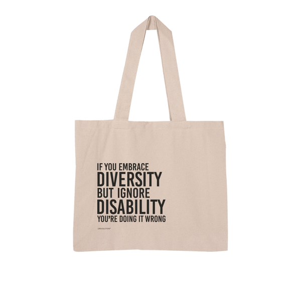 "Picture of URevolution's Embrace Diversity natural organic tote bag featuring our original Embrace Diversity phrase printed in black upper case letters: ""If you embrace diversity but ignore disability, you're doing it wrong."" The phrase takes up three-quarters of the tote bag."