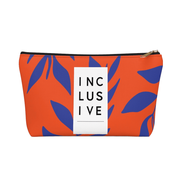 The pouch has a fabric pattern that is orange with royal blue leaves. There is a white vertical strip that has INCLUSIVE written vertically with three letters per line. The strip takes up one third of the front area of the pouch.