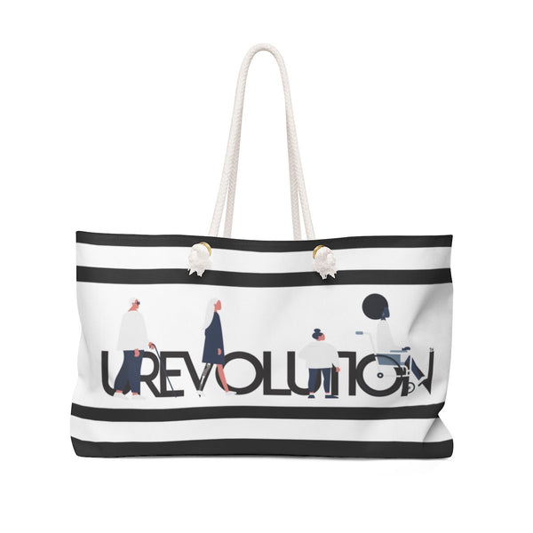 Front view of black and white striped bag with white handles and a graphic design that includes the word URevolution.
