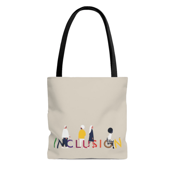 A photo of URevolution's inclusion tote bag, which has the word INCLUSION printed in rainbow-like colors on one side. Four diverse disabled people have incorporated into the word INCLUSION: a blind person, a person with an invisible illness, a disabled person with a prosthetic limb, and a disabled person in a wheelchair. the inclusion tote is canvas color with black straps.  Edit alt text