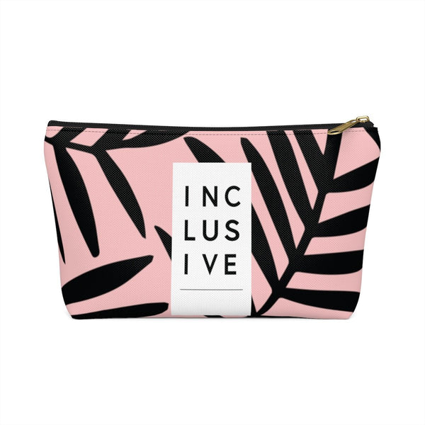 "Inclusive Accessory Pouch, Black Fern-Accessory Pouches-Large-Black-Uncomfortable Revolution-The pouch has a patterned fabric that is pale pink with black fern leaves. There is a white vertical strip that has INCLUSIVE written vertically with three letters per line. The strip takes up one third of the front area of the pouch. On the back is text printed in small white letters says ""For every body www.urevolution.com"" in white. ""Every"" is in italics for emphasis."