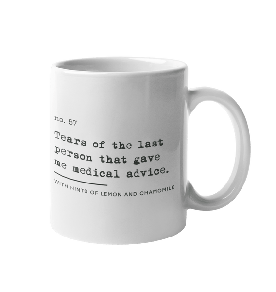 "This is a photo of URevolution's No Medical Advice Coffee Mug 11oz - Left Handed. The mug is white, with black text that reads: ""no. 57. Tears of the last person that gave me medical advice. With hints of lemon and chamomile."" The Uncomfortable Revolution logo is displayed in smaller text below the medical advice phrase."