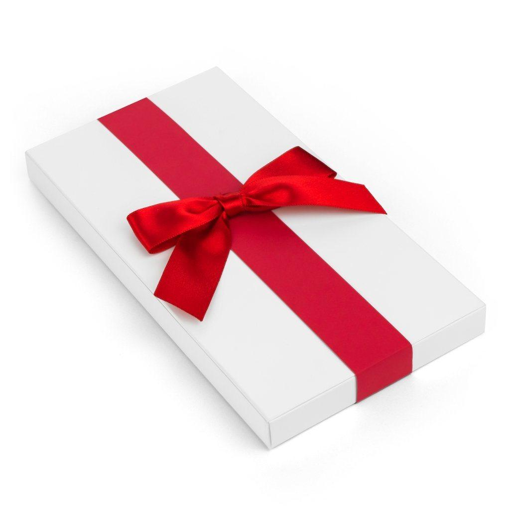 A top view of the optional gift wrapping of the biodegradable phone case in a white box wrapped with an elegant red ribbon.