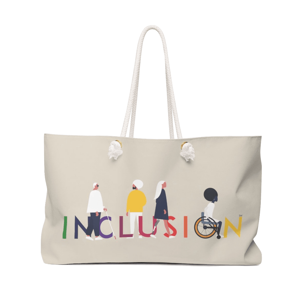 "Picture of an oversized weekender bag in every possible way. The bag has a big, bold graphic message on the side: ""INCLUSION."" The word INCLUSION is printed in large type in the colors of the rainbow. Four diverse disabled people are incorporated into the word. The bag has long cream-colored rope handles fed through gold color metal grommet."
