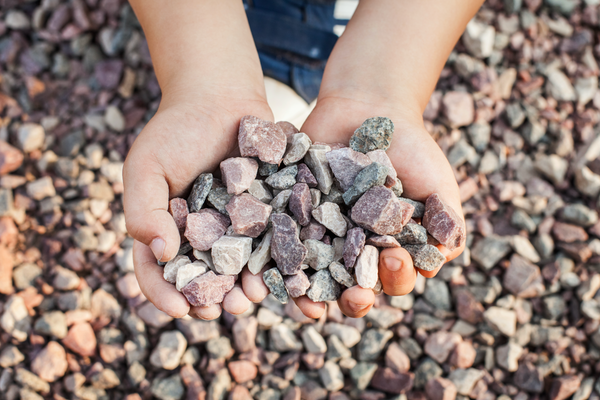 Boy with rocks in his hands