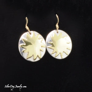 Brilliant brass sun on sterling silver background with gold-filled ear wires.