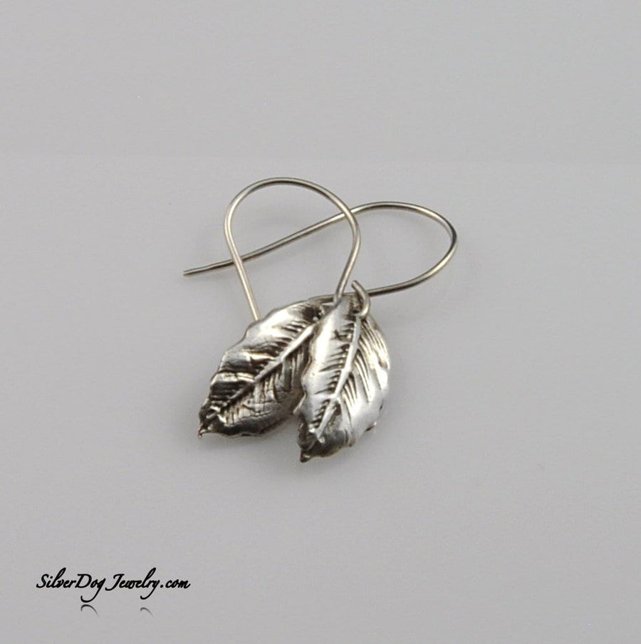 Petite textured leaf earrings of fine silver metal clay with sterling ear wire at silverdogjewelry.com