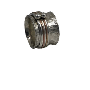 Sterling silver spinner ring with gold wire and sterling beads.