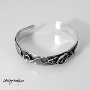 sterling silver cuff bracelet, free form Swirls, curls, bits and pieces add texture