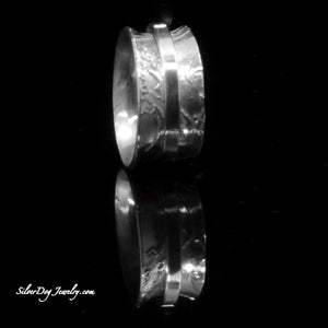Spinner ring in solid textured sterling silver with one spinner band
