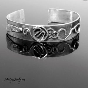 sterling silver cuff bracelet with swirled wires and pieces for texture