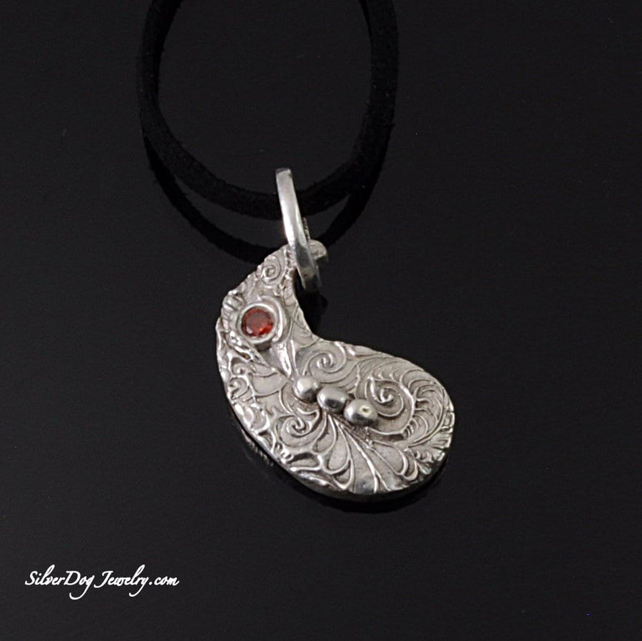 Sterling Silver metal clay textured paisley pendant with orange cz