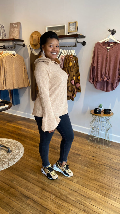 You'll feel cozy and warm when wearing this bell sleeve hoodie at home or outdoors. Its extra-long, flared sleeves will keep the chill off your hands so that you can enjoy the moment. Perfect to wear with jeans or leggings.      Available in S, M, and L Long sleeves 95% Cotton, 5% Spandex