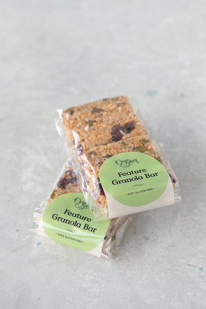 Load image into Gallery viewer, stack of 2 gluten free granola bar packs, 2 squares in each compostable cellulose bag with Origin Bakery sticker