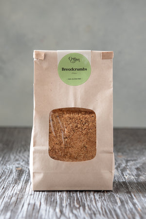 Load image into Gallery viewer, toasted gluten free breadcrumbs 500g in paper window tin tie bag with Origin Bakery sticker
