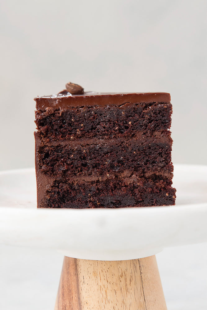 Load image into Gallery viewer, gluten free Vegan Ganache Cake slice on cake stand, dairy-free egg-free
