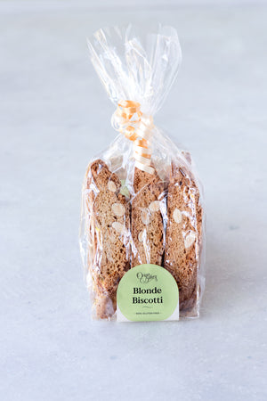 Load image into Gallery viewer, package of 6 gluten free almond orange biscotti in compostable cellulose bag with ribbon and Origin Bakery sticker