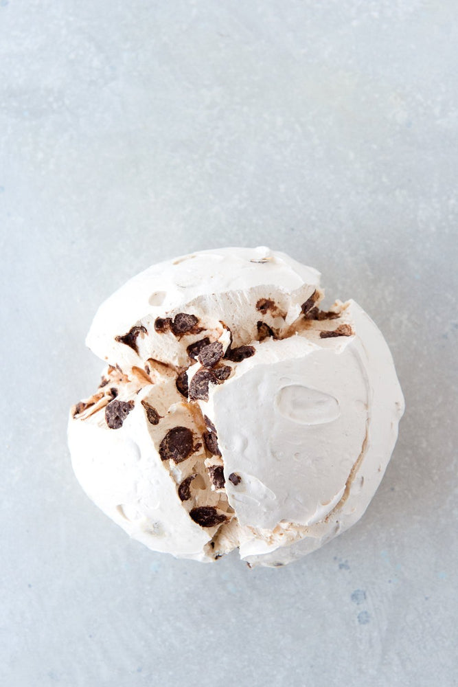 Load image into Gallery viewer, top view large chocolate chip meringue