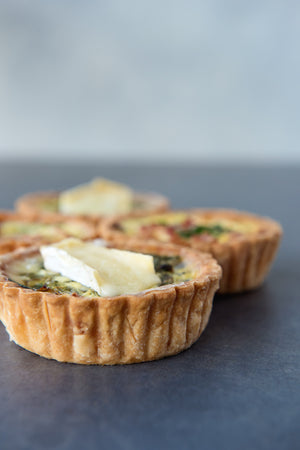 Load image into Gallery viewer, side view gluten free spinach brie quiche