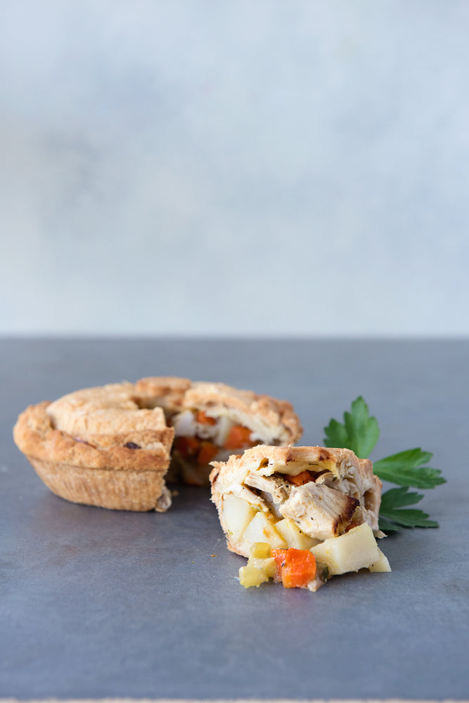 Load image into Gallery viewer, gluten free chicken pot pie, with piece cut out displayed in front