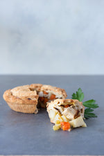 gluten free chicken pot pie, with piece cut out displayed in front